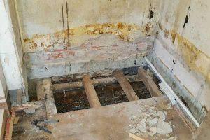 damp walls and rotten floor