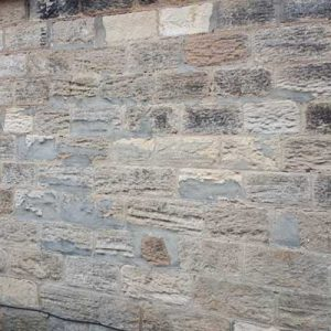 Stone walls with cement mortar causing damage - Harrogate